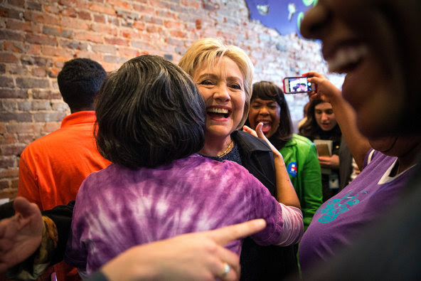 Hillary Clinton was hugged by a supporter during a surprise visit on Saturday to Yo Mama's in Birmingham, Ala.