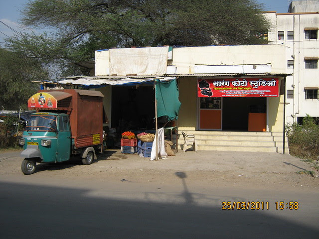 Vegetable shop and Sarang Photo Studio at the entrance of the lane to Prathamesh Park, off Balewadi Phata, Baner Pune