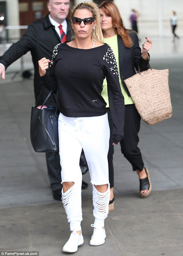 Covering up: Katie was then seen later on leaving the studios with a black jumper layered on top