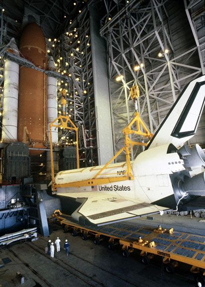 Space shuttle Enterprise is about to be attached to its external fuel tank and twin solid rocket boosters at Vandenberg AFB in California.