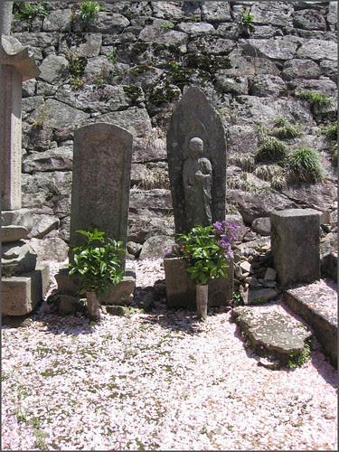 051 stone memorials and fallen petals