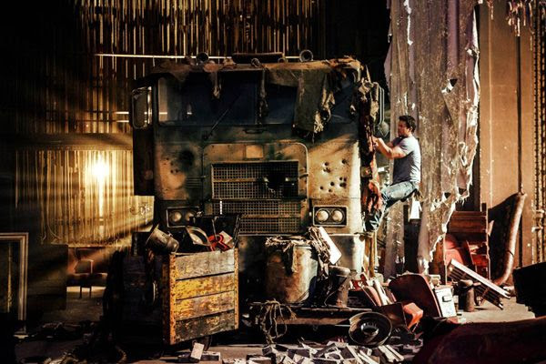 Cade Yeager (Mark Wahlberg) stumbles upon Optimus Prime, disguised as a decrepit truck, inside an abandoned Texas movie theater in TRANSFORMERS: AGE OF EXTINCTION.