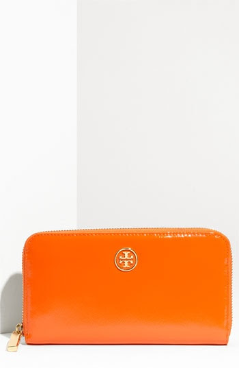 obsessed with tangerine colored ANYTHING! i was literally SO close to buying this... then i saw a black clutch i just couldn't resist!!