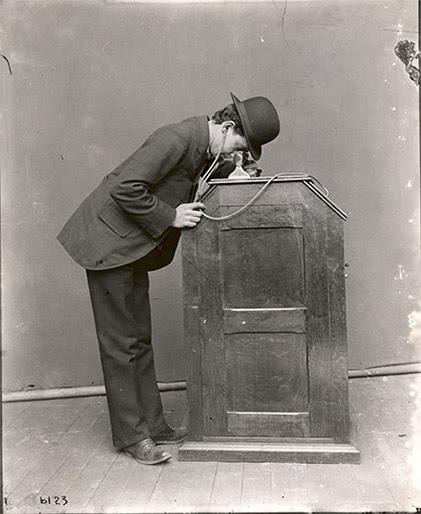 Publicity photograph of man using Edison Kinetophone, 1895