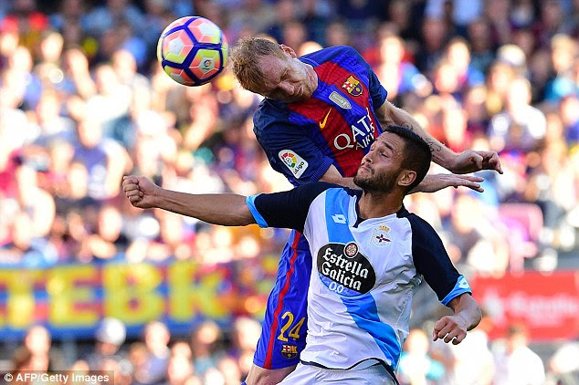 Mathieu rises highest to beat Andone to an aerial ball as Barca dominated before the break