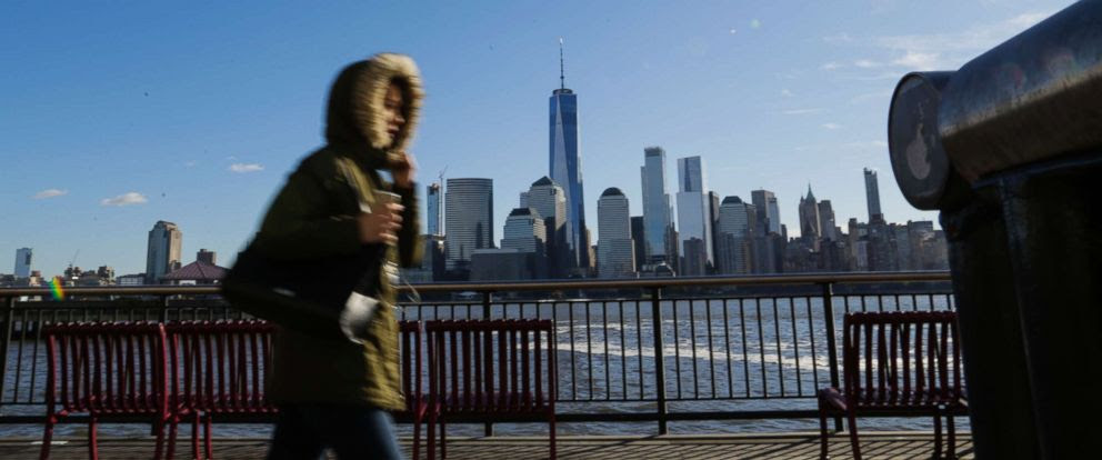 PHOTO: A commuter from New Jersey to New York, bundled up against the wind and the cold temperatures on November 10, 2017 in Exchange Place, Jersey City, N.J. The National Weather Service issued a freeze warning for the area.