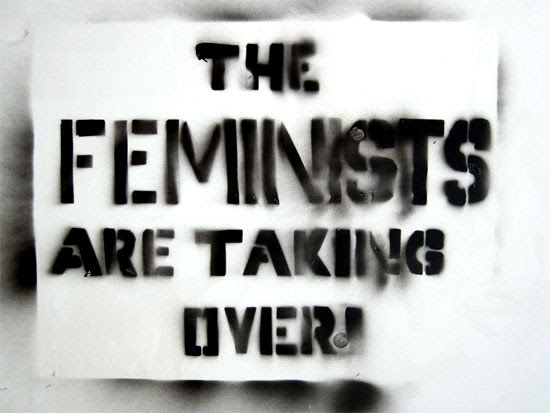 sign stencilled in spraypaint: 'The Feminists are Taking Over' | Tacky Harper's Cryptic Clues