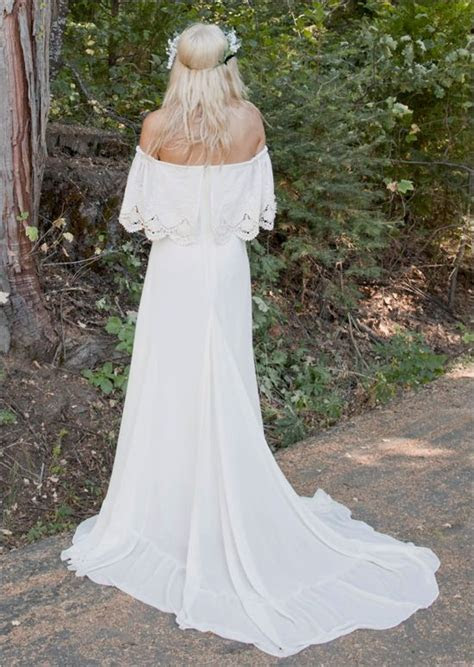 Bohemian bridal gown with train and crocheted lace that
