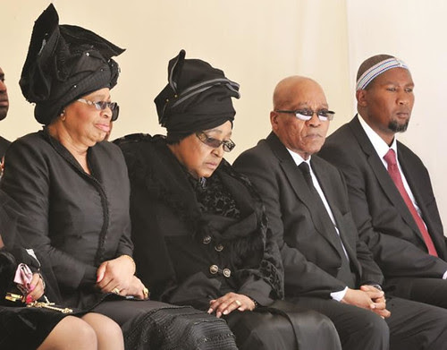 The burial of former South African President Nelson Mandela on Sunday December 15, 2013. Graca Machel, Winnie Mandela, President Jacob Zuma and Mandla Mandela. by Pan-African News Wire File Photos