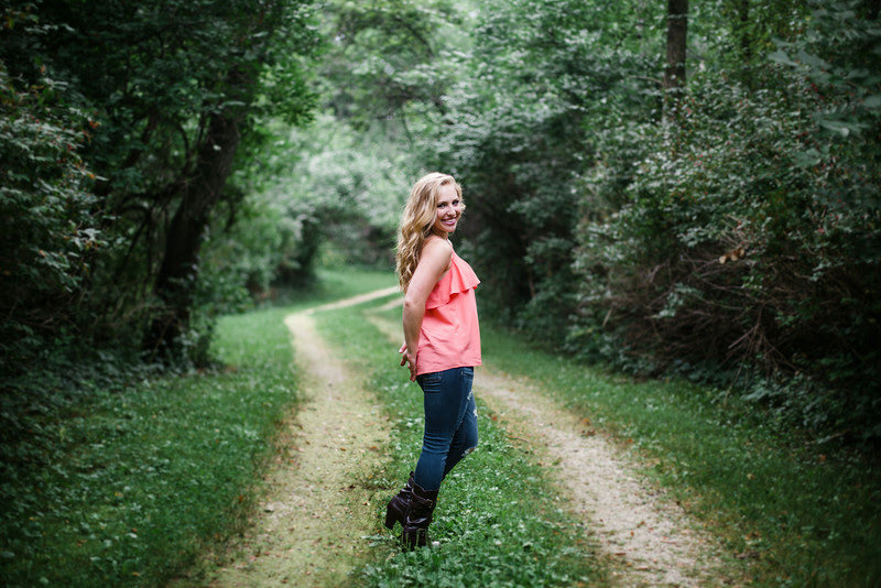 Photos taken outdoors in woods, nature, outdoors setting outside Rockford IL on private property. These summer time senior photos were taken in the early evening. Photo by Mindy Joy Photography