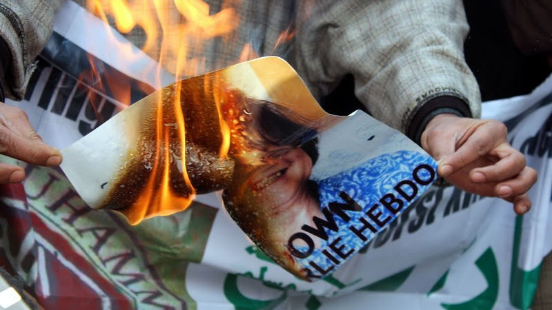 A protest rally against French satirical magazine Charlie-Hebdo was held in Kashmir's Old City. Protestors effigy and Charlie Hebdo posters were set on fire by angry protesters . Image by Adil Hussain. Copyright Demotix (23/1/2015)