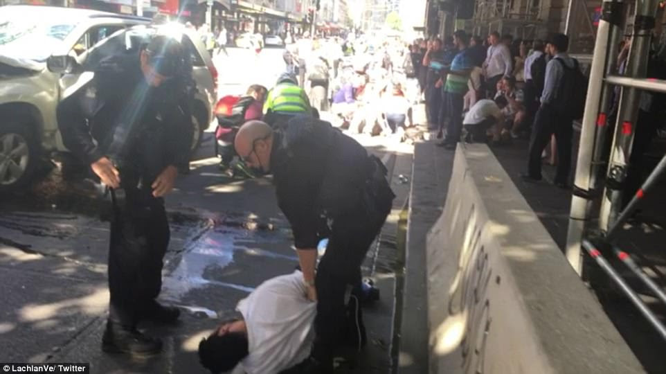Victoria Police dragged the man in a white shirt (pictured) from the white Suzuki to the gutter shortly after the incident
