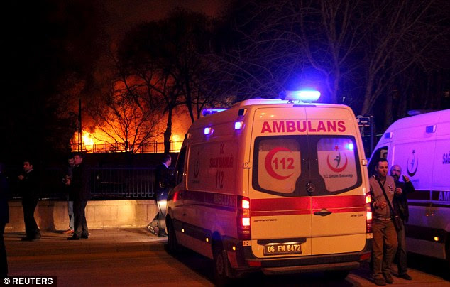 Rescue: An ambulance arrives, with the fire seen in background, close to the site of an explosion in Ankara