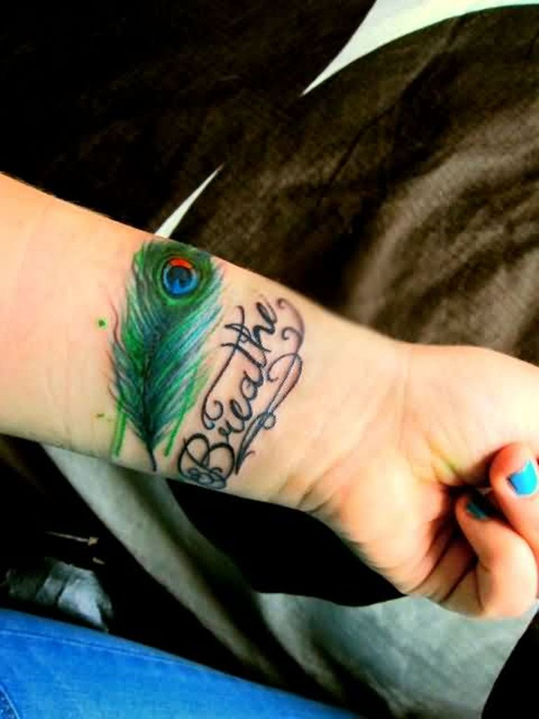 57 Attractive Wrist Feather Tattoos