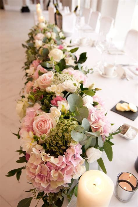 25  best ideas about Wedding top table flowers on