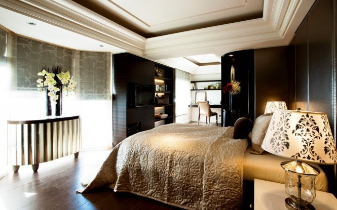 The master bedroom is a sumptuous scheme full of rich hues and plush comfort.
