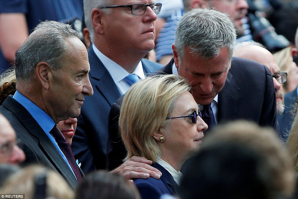 Clinton, New York Mayor Bill de Blasio (right) and U.S. Senator Chuck Schumer (left) attend ceremonies to mark the 15th anniversary of the September 11 attacks