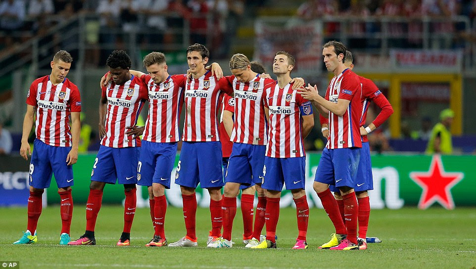 The Atletico Madrid players look despondent on the centre circle after Juanfran's miss and there was no way back for Simeone's side