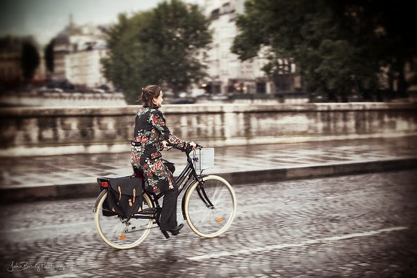 Brave Bicycle Girl Has Pont Neuf Bridge All To Herself Simple shot that I like and I don't know why. Probably all the photos I've seen by many of the great French photographers on the same subject...- Click for full sized Hi-Res Image - JohnBrody.com -  JohnBrody.blogspot.com