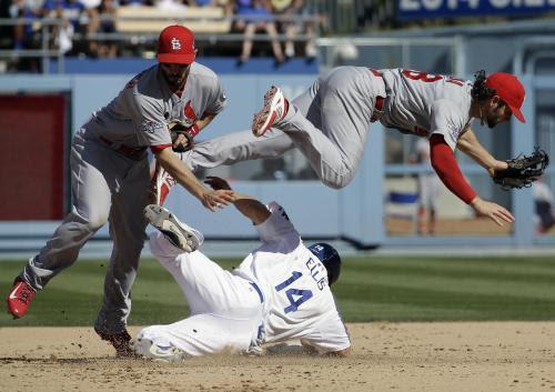 Ellis, Carpenter,Kozma<br />October 16, 2013<br />Dodger Stadium<br />Los Angeles, California<br />Photo by David J. Phillip/AP