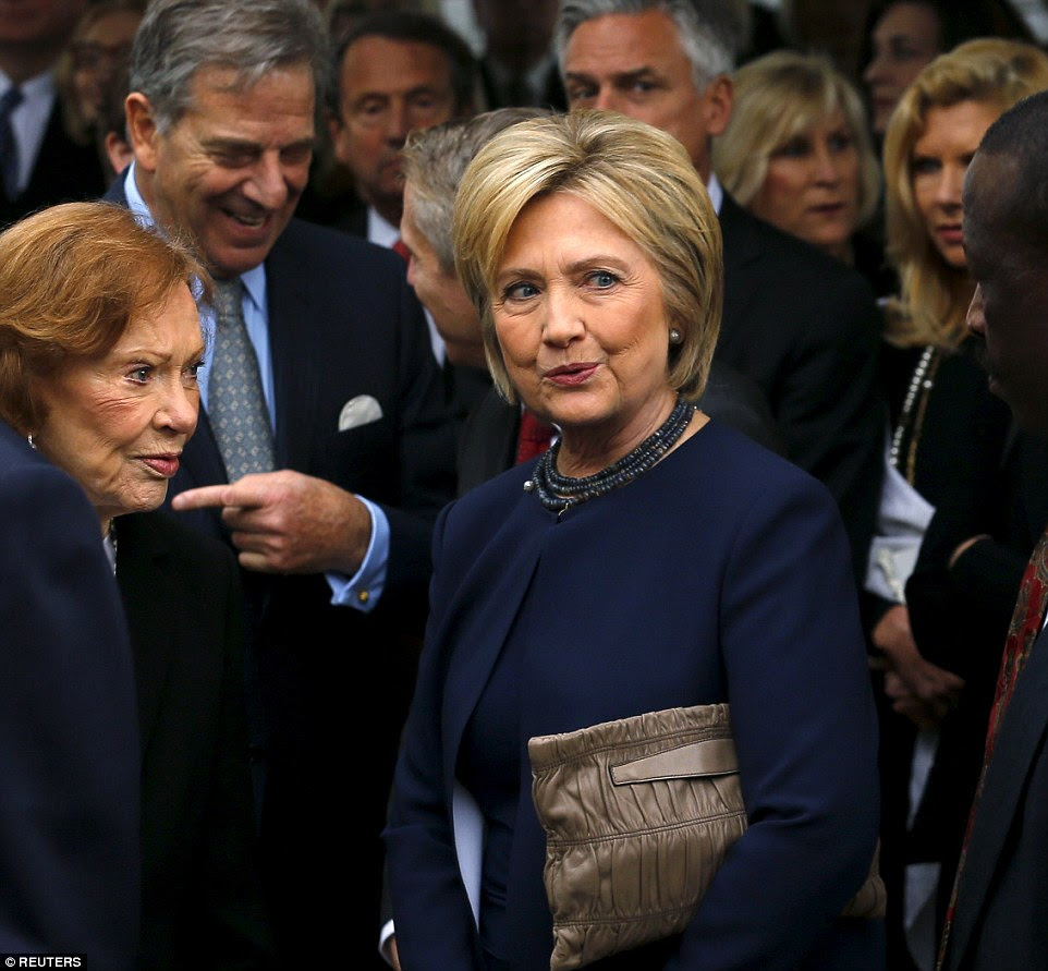 Former first lady Rosalynn Carter (left) and former first lady Hillary Clinton wait in line to pay their respects during Reagan's funeral