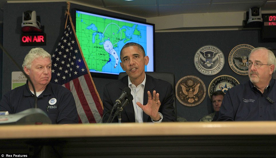 Take care: Richard Serino, deputy administrator of FEMA, President Obama and Craig Fugate, administrator of FEMA give a briefing on Hurricane Sandy at FEMA Headquarters, in Washington, D.C. on Sunday
