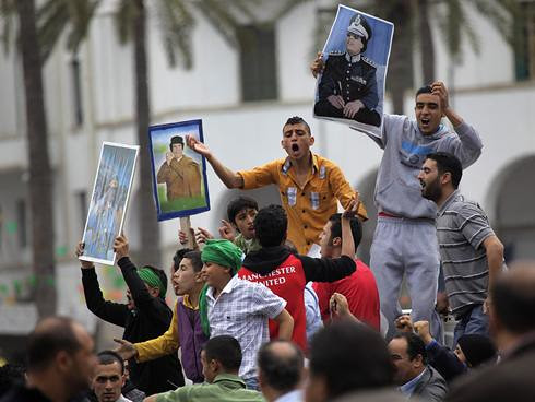 Libyans demonstrating in support of the government in the capital of Tripoli. Reports indicate that military forces are headed toward the city of Benghazi that is under occupation by the western-backed rebels. by Pan-African News Wire File Photos