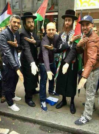 Neturei Karta doing inverted Nazi salute the Quenelle  with Arabs at anti-Israel rally in Manchester, UK 7-2014