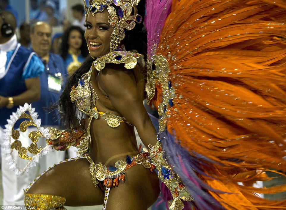 Brazilian model Raisa de Oliveira, from theBeija-Flor samba school, dances during the first of two nights in the Sambadrome in Rio