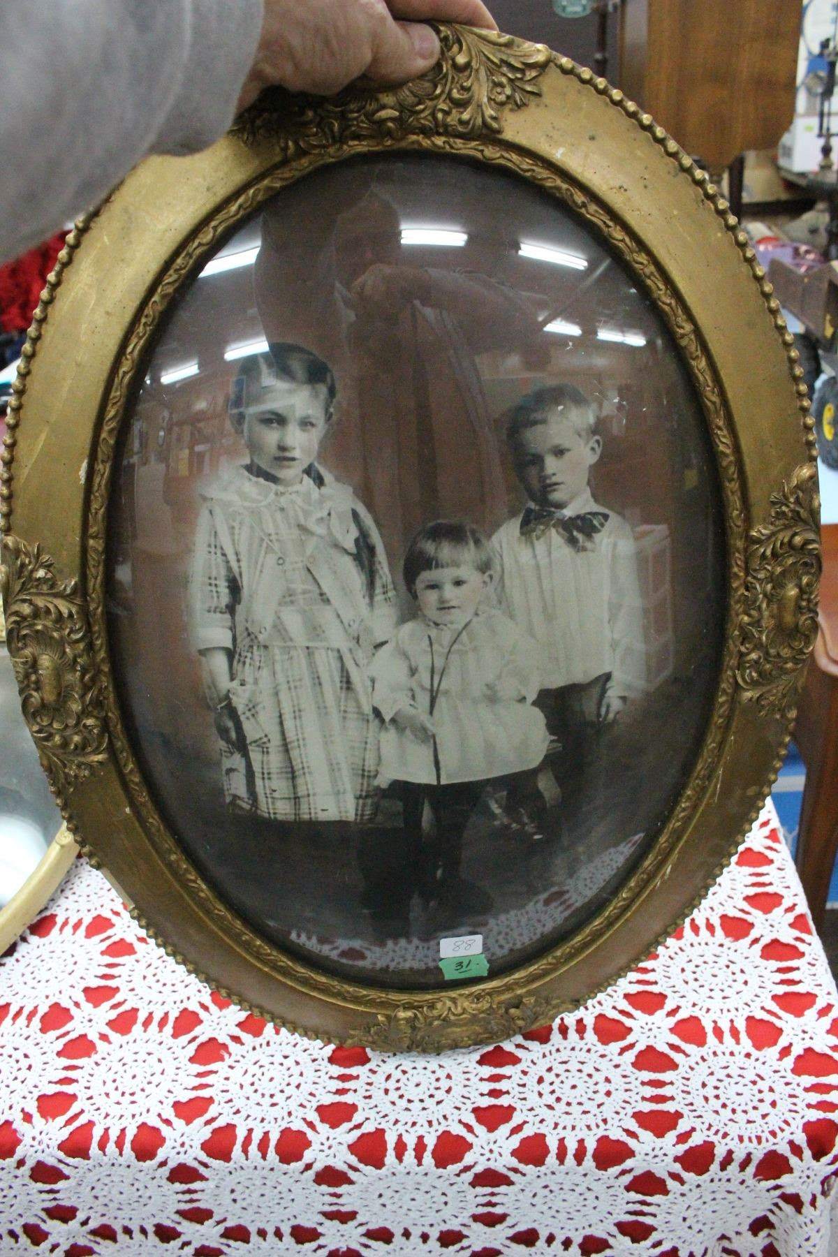 Portrait Of Three Children In A Wooden Oval Convex Glass Frame