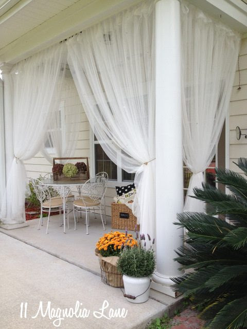 Sheer curtains on back porch