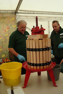 Pressing apples at the Autumn Fair