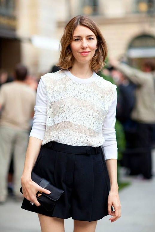 LE FASHION BLOG STREET STYLE SOFIA COPPOLA PARIS COUTURE 2012 EMBELLISHED LACE KNIT SWEATER TEXTURE PLEATED SHORTS SMALL CLUTCH SHORT BOB VIA MR NEWTON FOR HARPERS BAZAAR