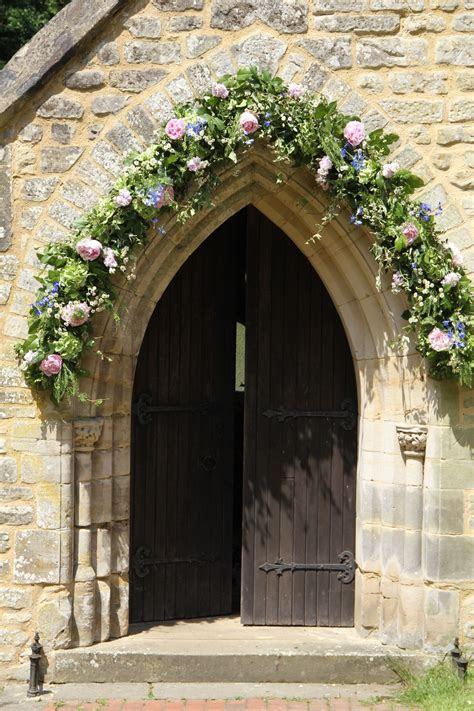 English church portal decorated for a wedding    Village