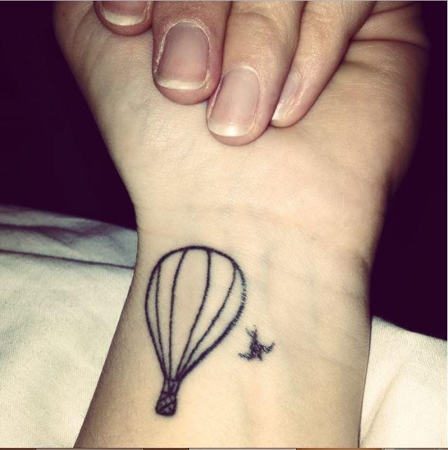 Tiny Hot Air Balloon Tattoo On Finger