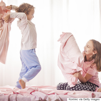 sibling fighting in bed