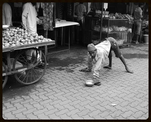 Onions Are More Epensive  Than Four Legged Beggars by firoze shakir photographerno1