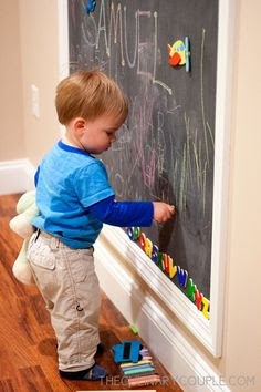"Double duty chalkboard/magnet wall. Paint it on and then ""frame"" it."