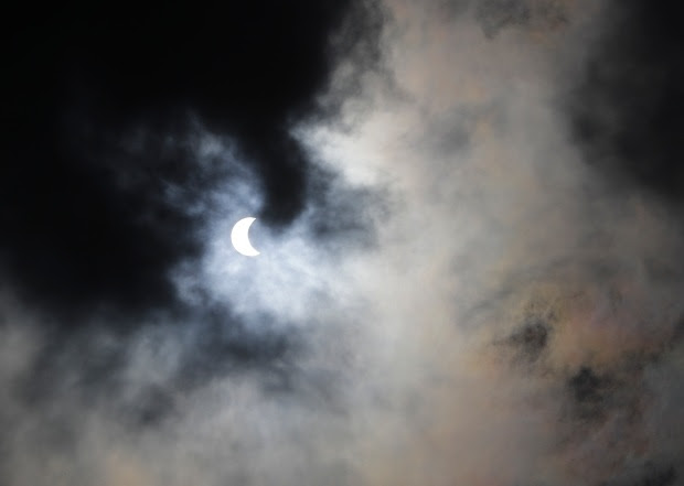This photo shows the beginning of a solar eclipse during a watch party at Holiday Park, Monday, Aug. 21, 2017, in Indianapolis. (AP Photo/Darron Cummings)