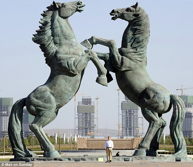 Power and vainglory: Peter Hitchens stands beneath the bronze horses in Genhis Khan Square in the empire city of Kangbashi