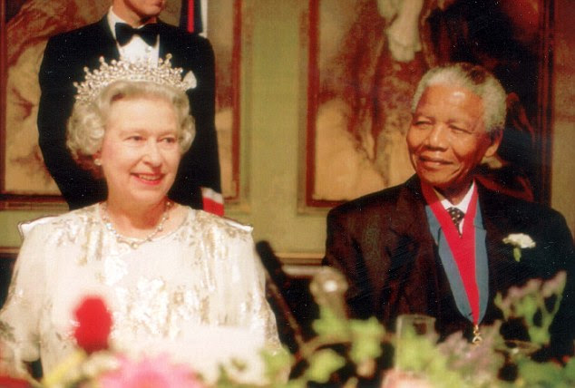Royal welcome: The Queen sits with South African President Nelson Mandela at a state banquet held in the Queen's honour in Cape Town in March 1995 - the first state visit to the country in almost 50 years