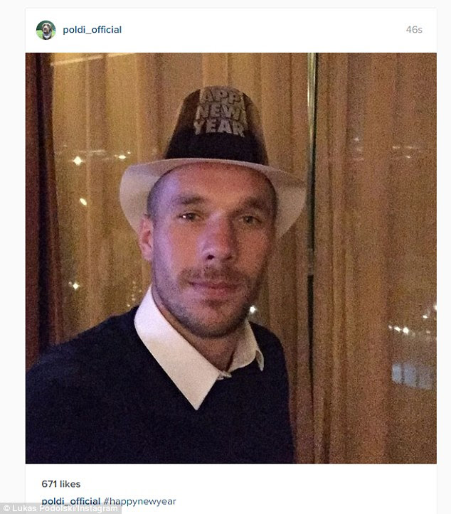The German forward Lukas Podolski sported some New year's headgear
