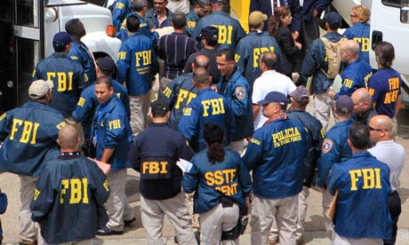 FBI agents wait to escort police officers