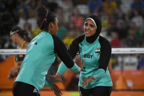 Egypt's Nada Meawad (L) and Egypt's Doaa Elghobashy react during the women's beach volleyball