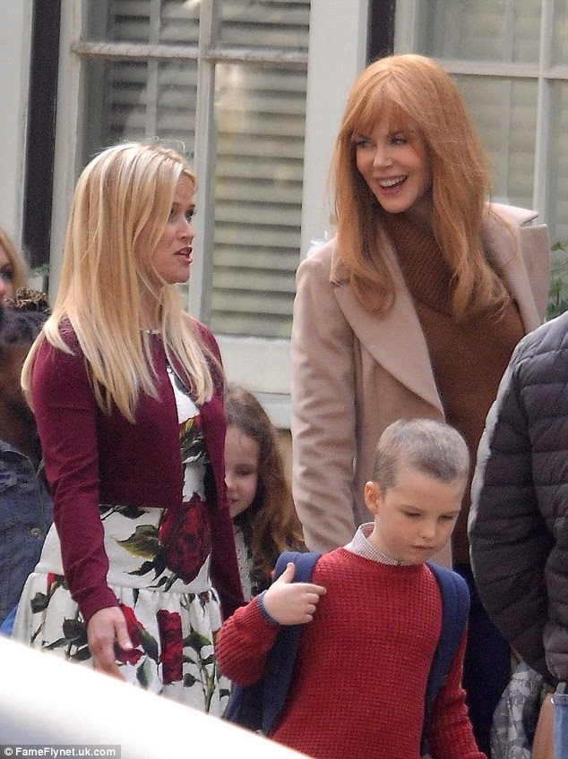 In character: At one point, Nicole and Reese were spotted sharing a joke as a hoard of backpack-wearing children run around them