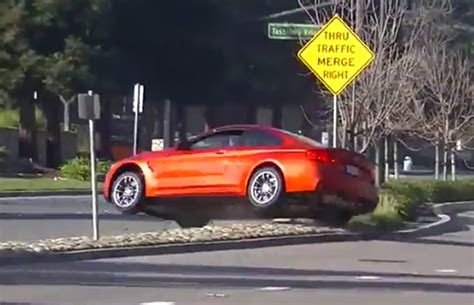 bmw  jumps  median strip  show  driver loses