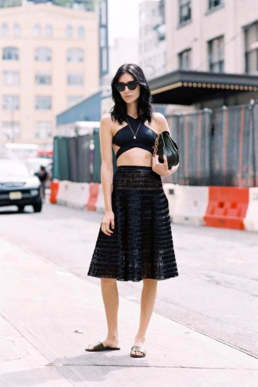 Le Fashion Blog Street Style All Black Look Sunglasses Strappy Crop Top Midi Skirt Chain Strap Bag Slide Sandals Via Vanessa Jackman