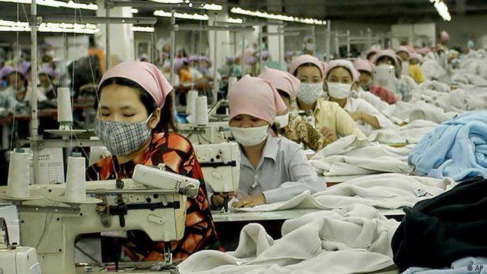 Cambodian garment factory workers toil at the W&D garment factory, just southeast of Phnom Penh, April 28, 2004. (AP Photo/Isabelle Lesser)