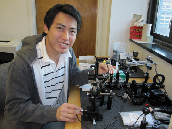 City Tech student Thinh Lê with the apparatus he built to measure the optical transmission of meteorite samples.