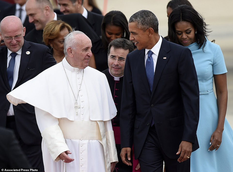 Pope Francis is scheduled to address Americans on the front lawn of the White House on Wednesday. Pictured above on Tuesday at the airport, being welcomed to the U.S. by President Obama  and his family